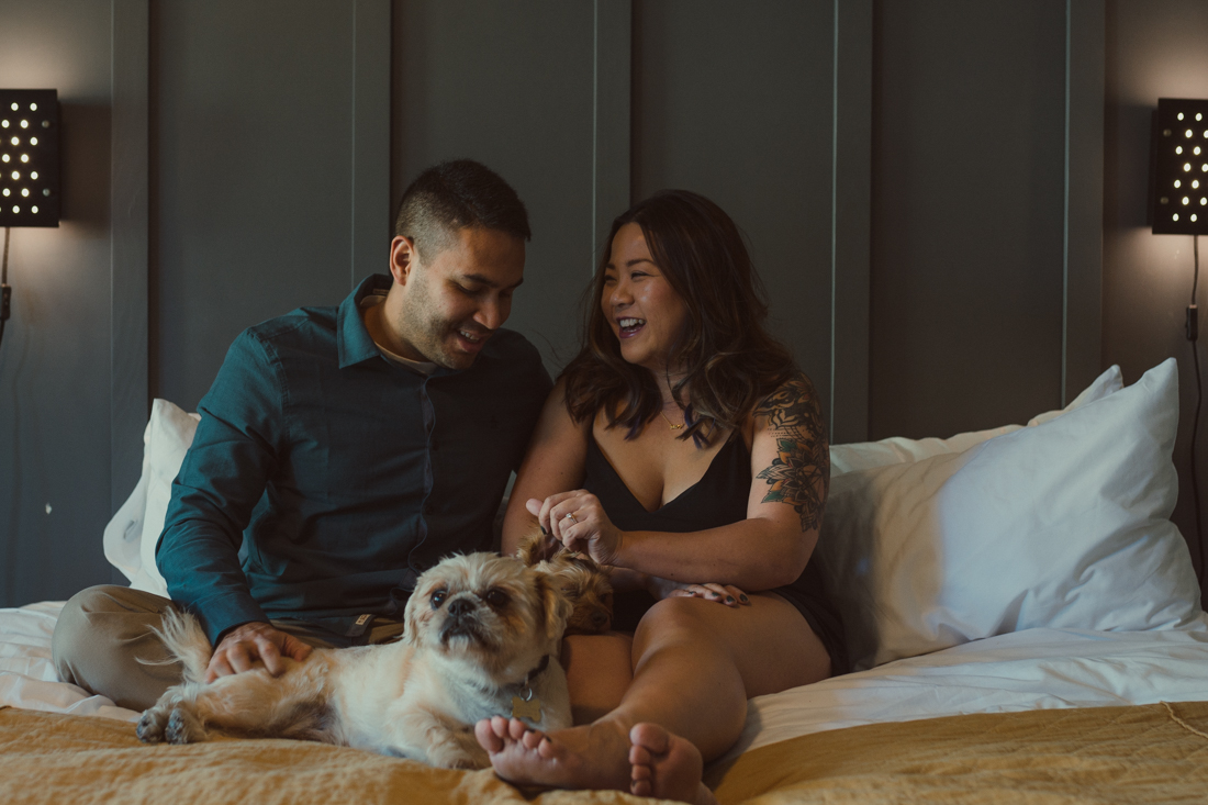 The Coachman Hotel couple cuddling on the bed pictures
