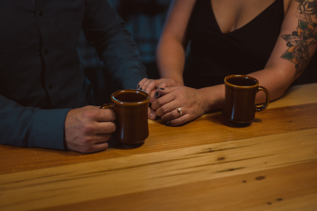 The Coachman Hotel couple holding hands at the cafe photo