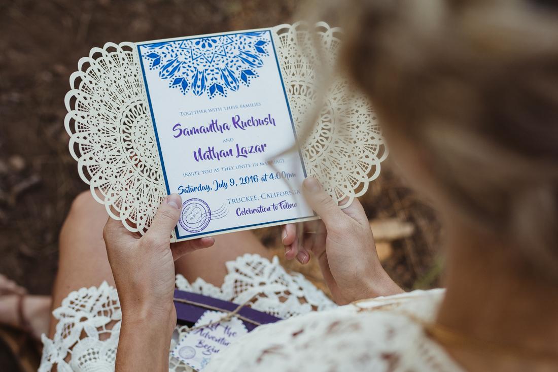 bride holding wedding bohemian invitation