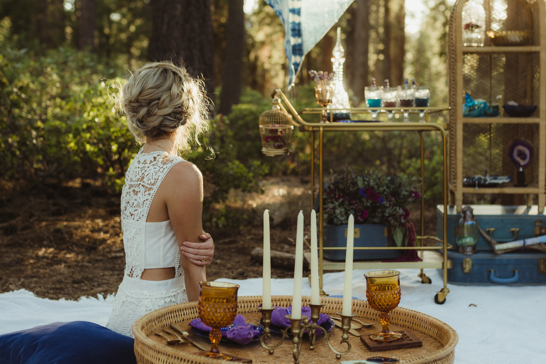 Bohemian styled shoot bride lounging photo