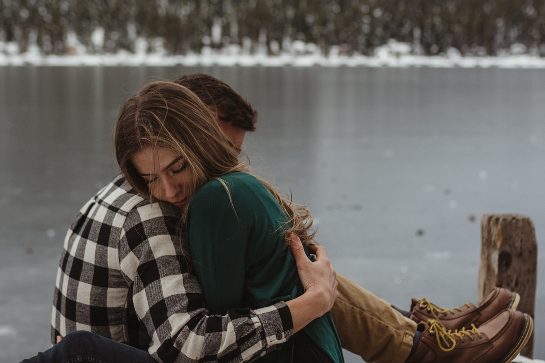 Couple hugging on a dock in Donner CA photo