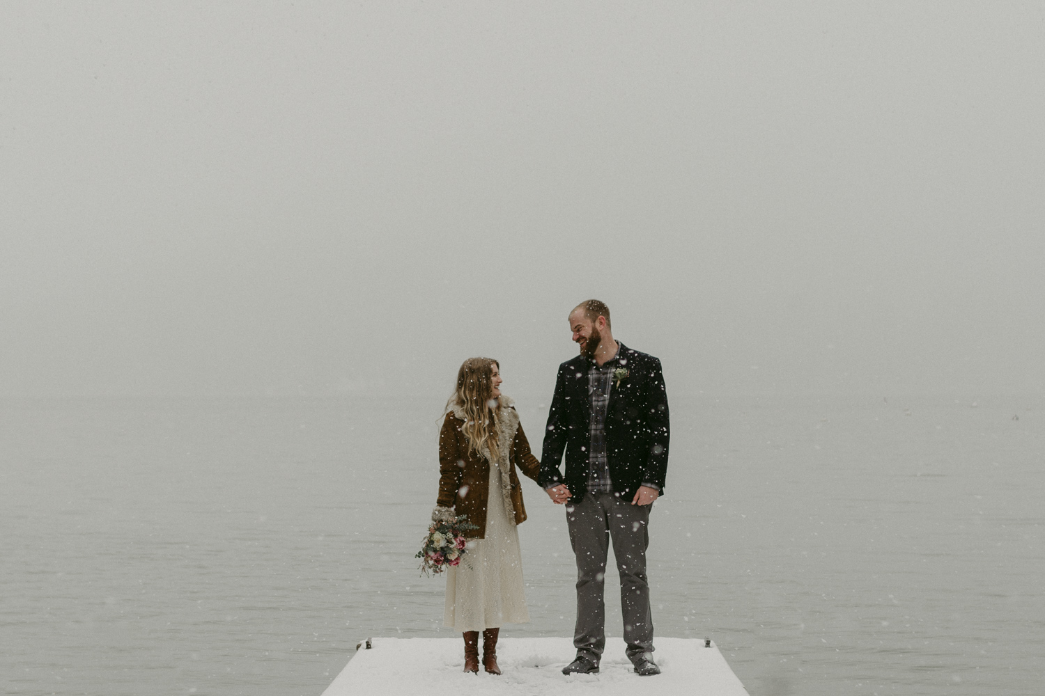 Nevada City, CA elopement photo couple holding hands at a dock in Scotts Flat Lake