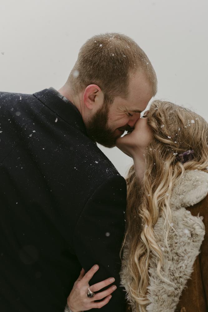 Nevada City, CA wedding couple kissing on the dock at Scotts Flat Lake