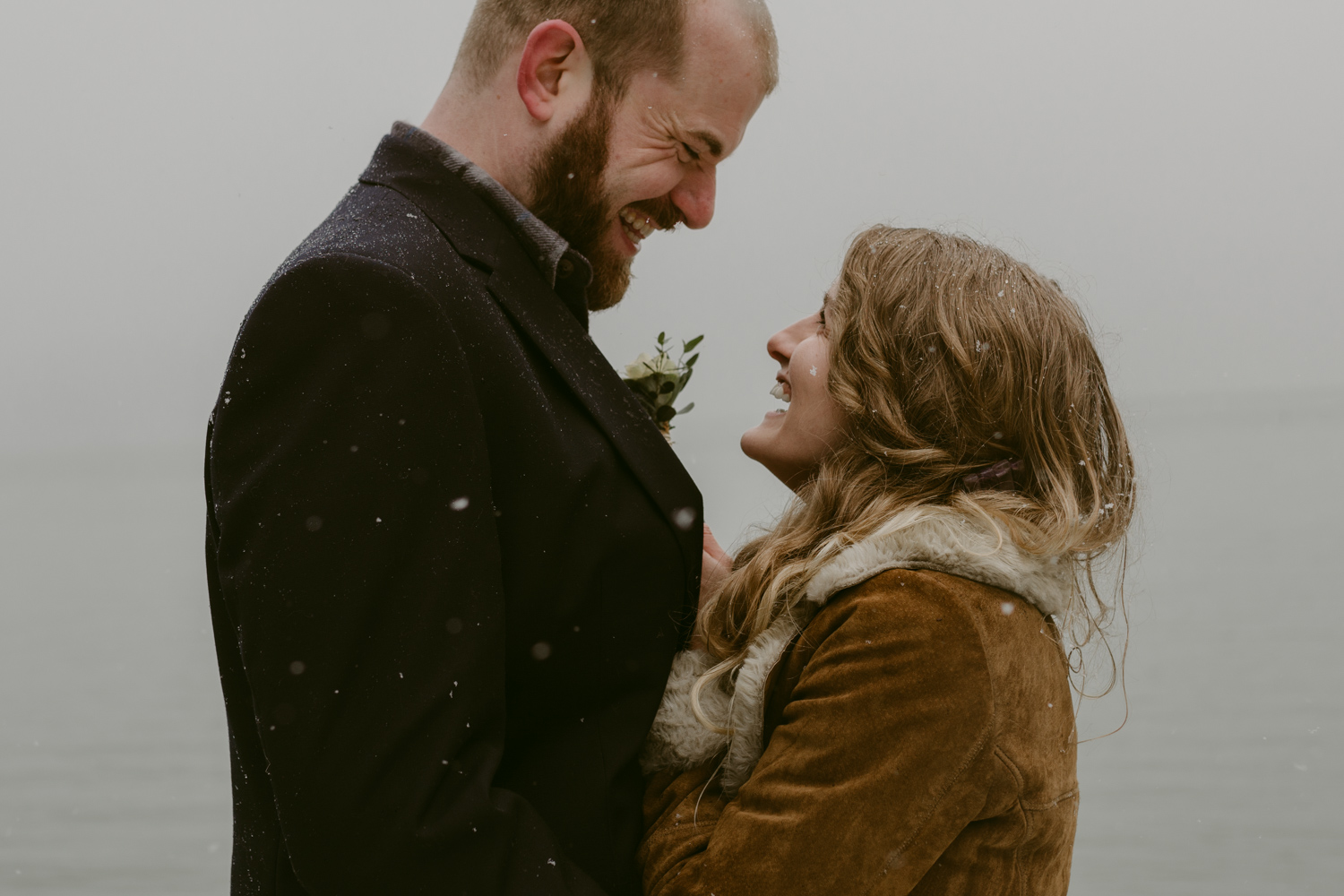 Nevada City, California Elopement couple laughing at each other photo