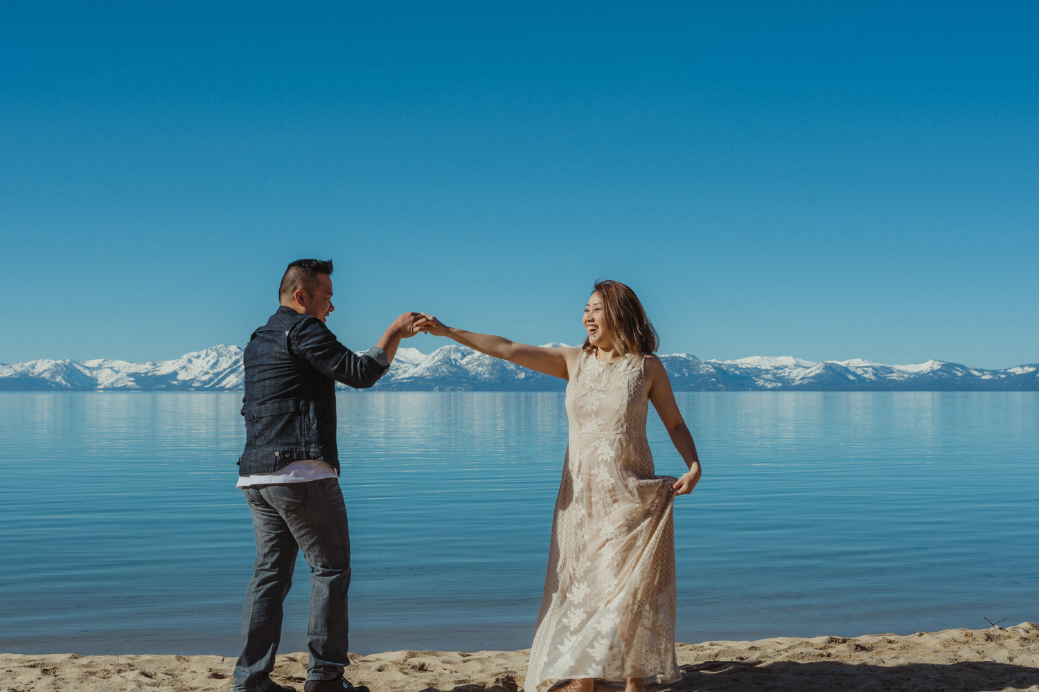 Lake Tahoe photography, couple dancing on the beach photo
