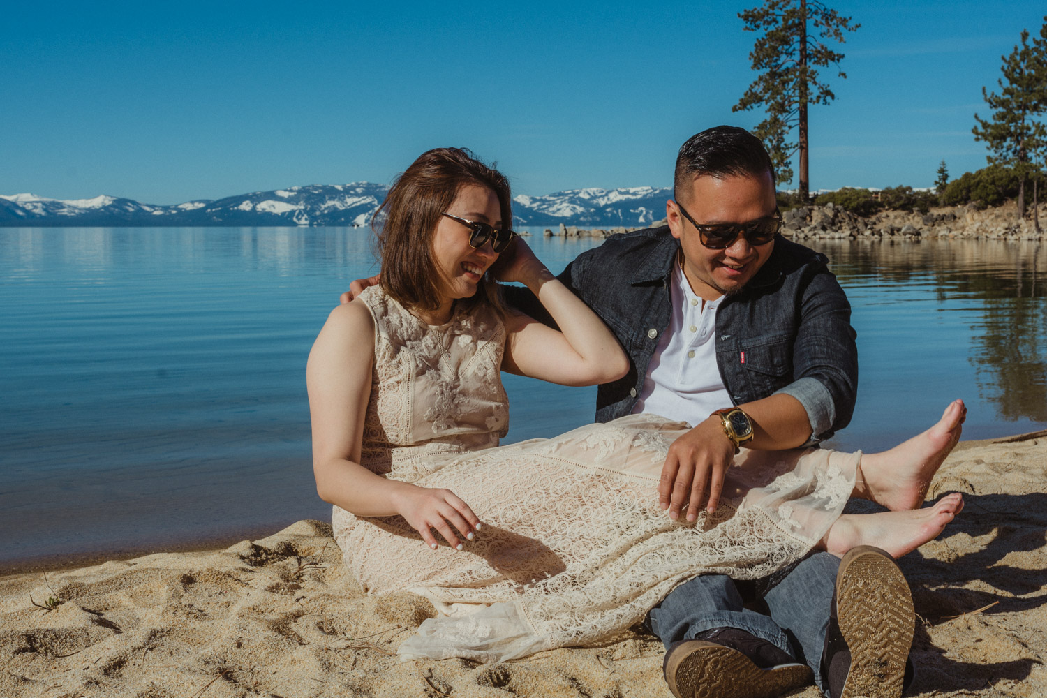 Lake Tahoe engagement session couple playing in the sand photo