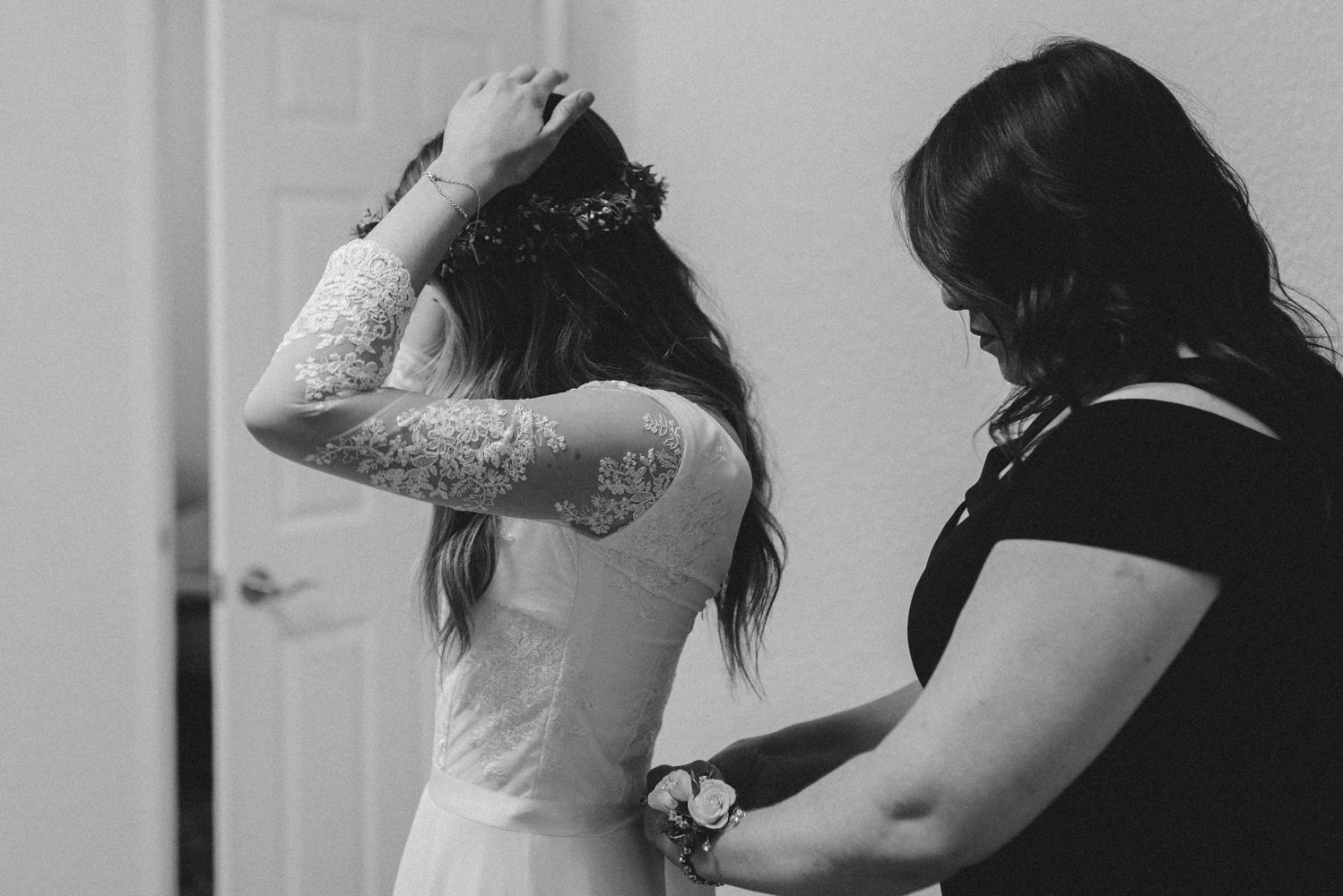 Vacaville wedding mom helping bride with her dress photo