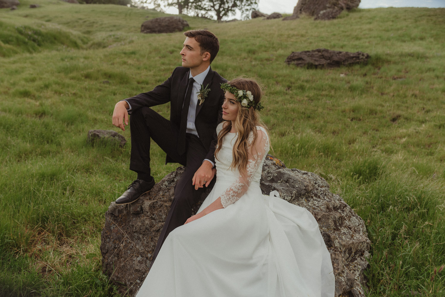 Vacaville wedding couple sitting on a rock on a hill photo