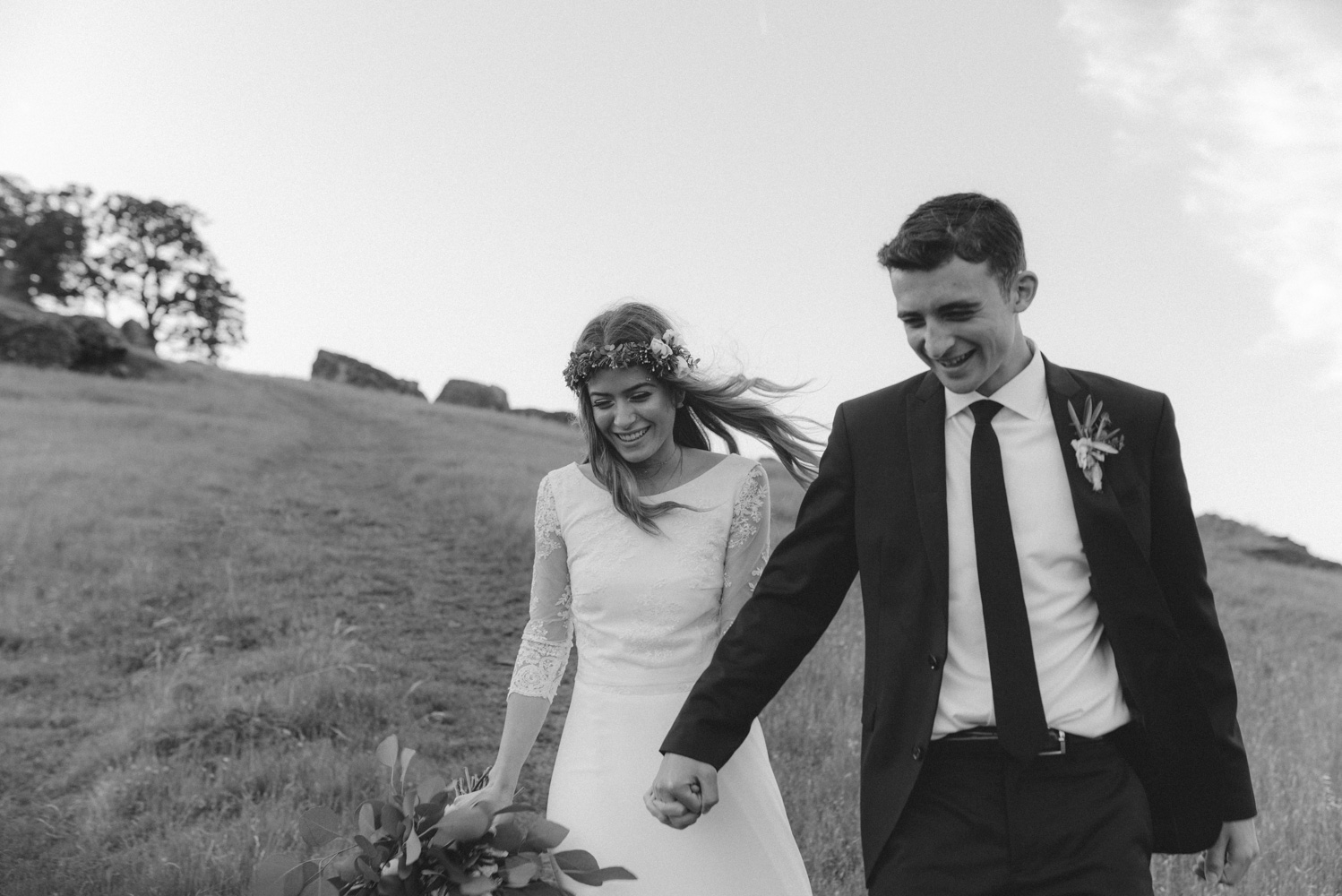 Vacaville wedding couple running down the hill photo