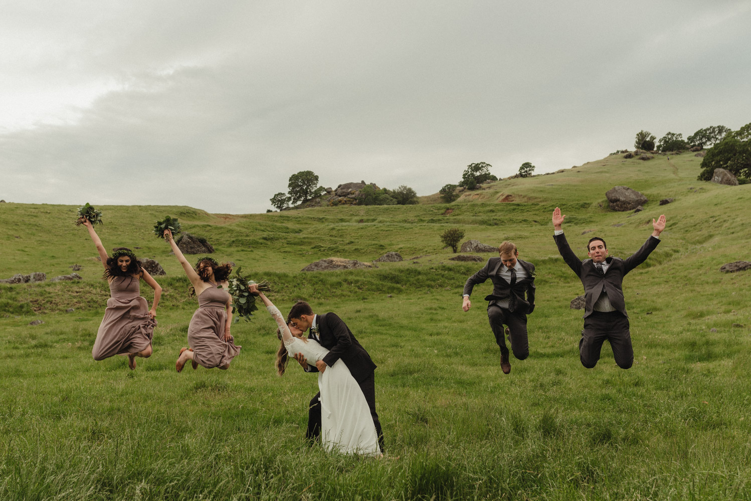 Vacaville wedding bridal party jumping in the air photo