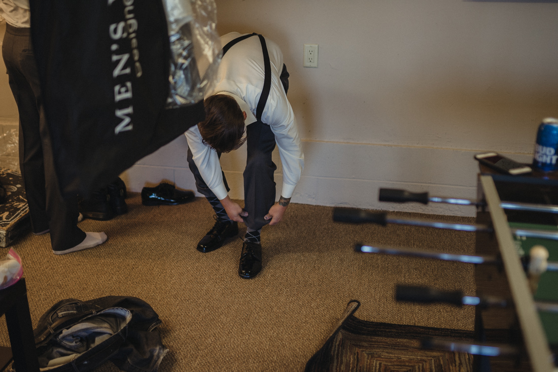 Tannenbaum Wedding Venue, groom putting on his shoes photo