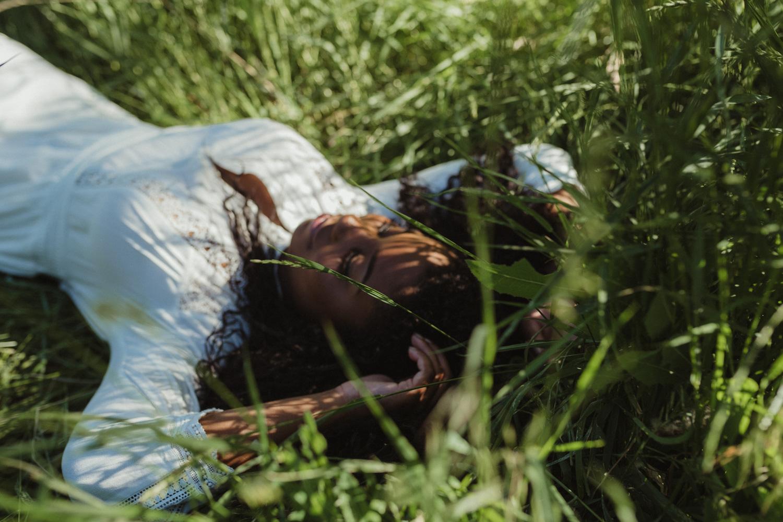 Reno senior photography, girl laying on the grass photo.