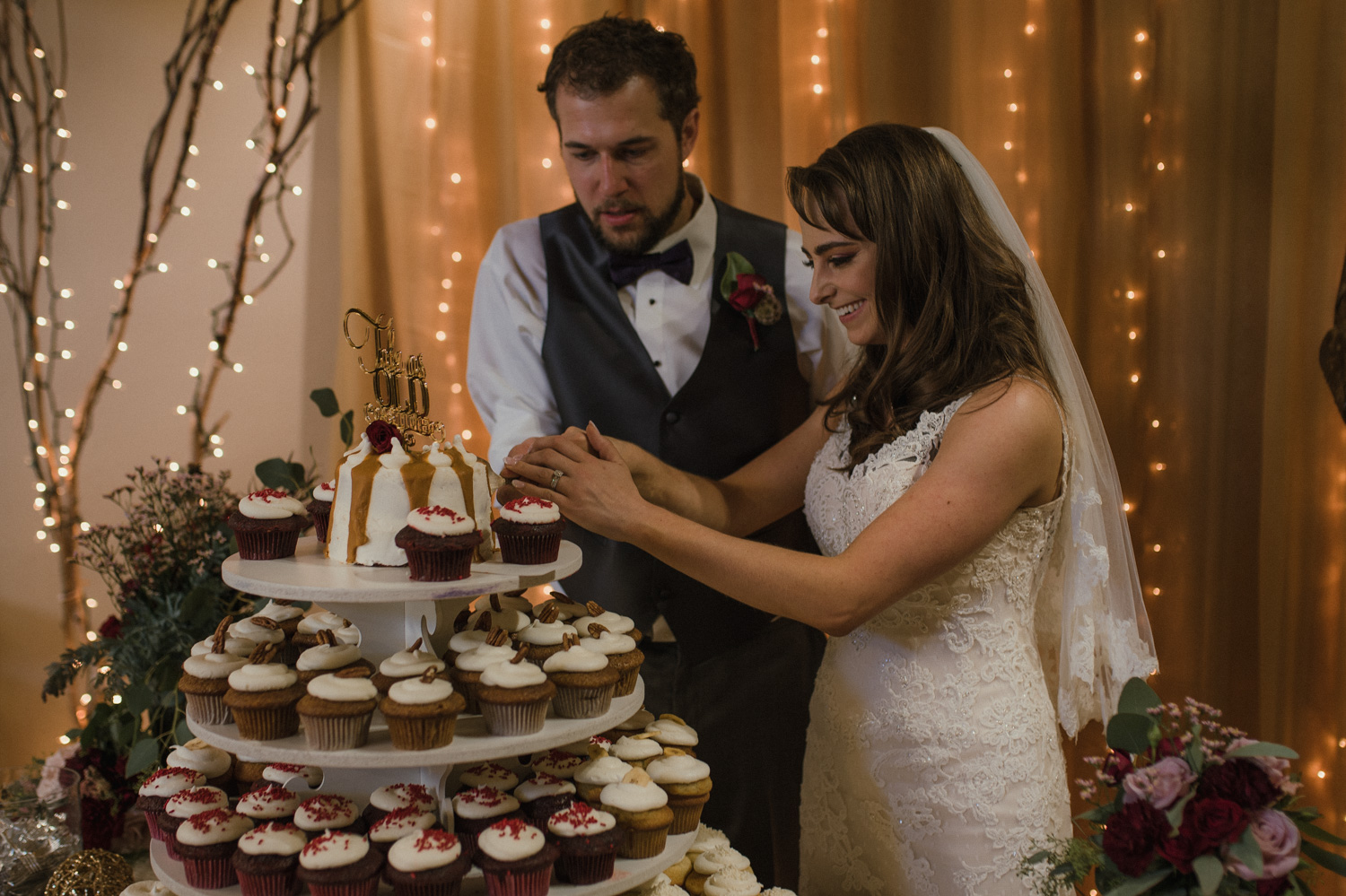 Wilbur D May Museum wedding, couple cutting their Beauty and the Beast cake photo