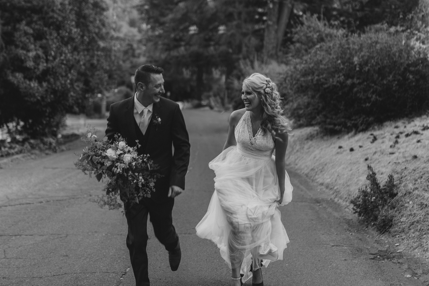 Wedgewood Sequoia Mansion wedding couple running up the hill photo