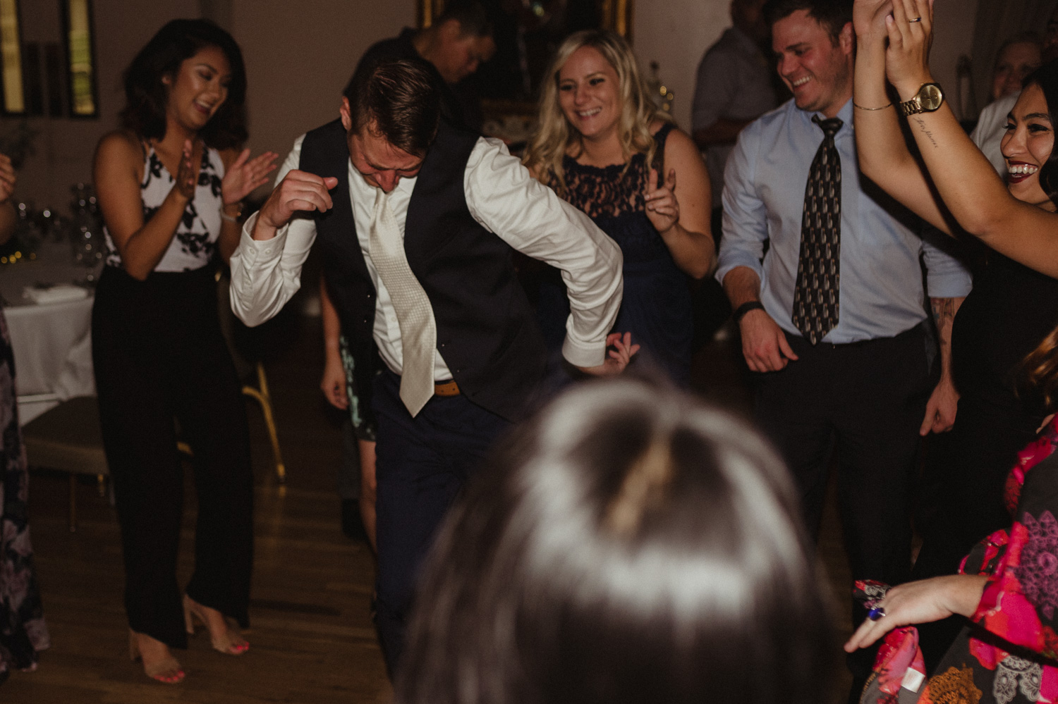 Wedgewood Sequoia Mansion wedding groom dancing between his friends photo