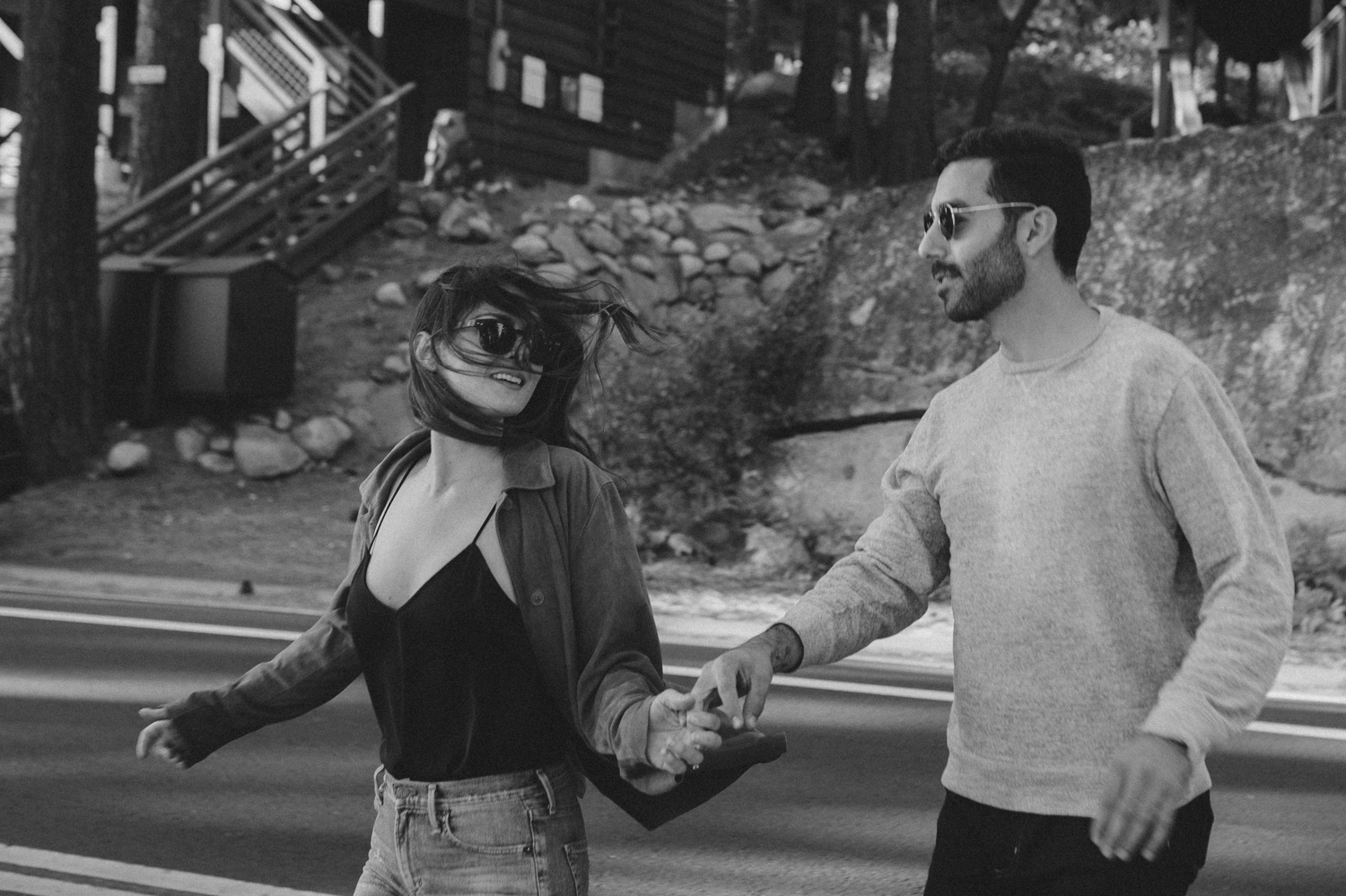 North Lake Tahoe engagement couple running on the streets of Donner photo