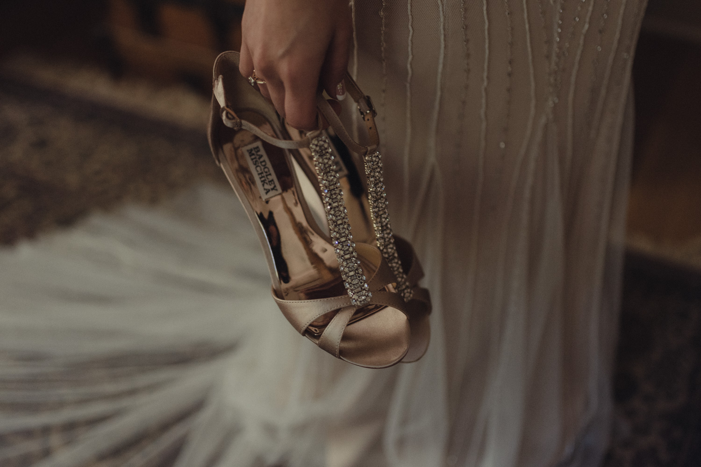 Nevada city wedding bride holding her shoes photo