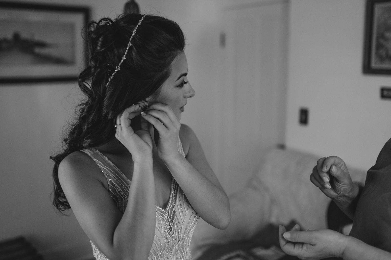 Nevada city wedding bride putting on earrings photo