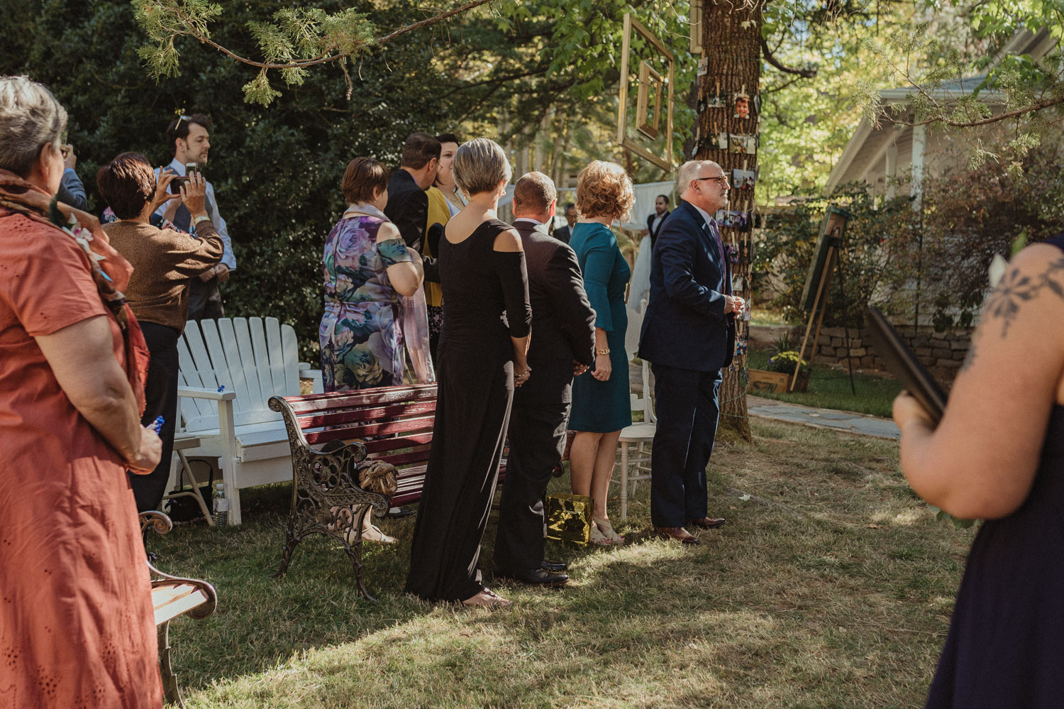 Nevada City wedding guests standing up for the bride photo