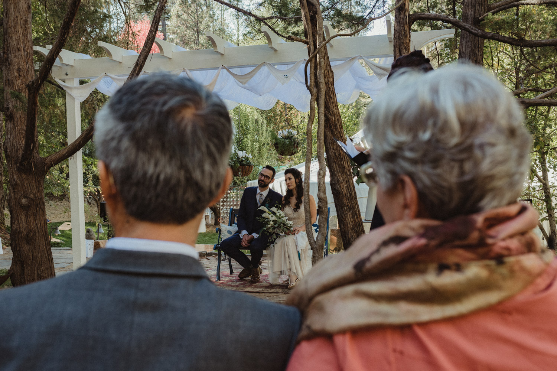 Nevada City wedding couple framed by parents photo