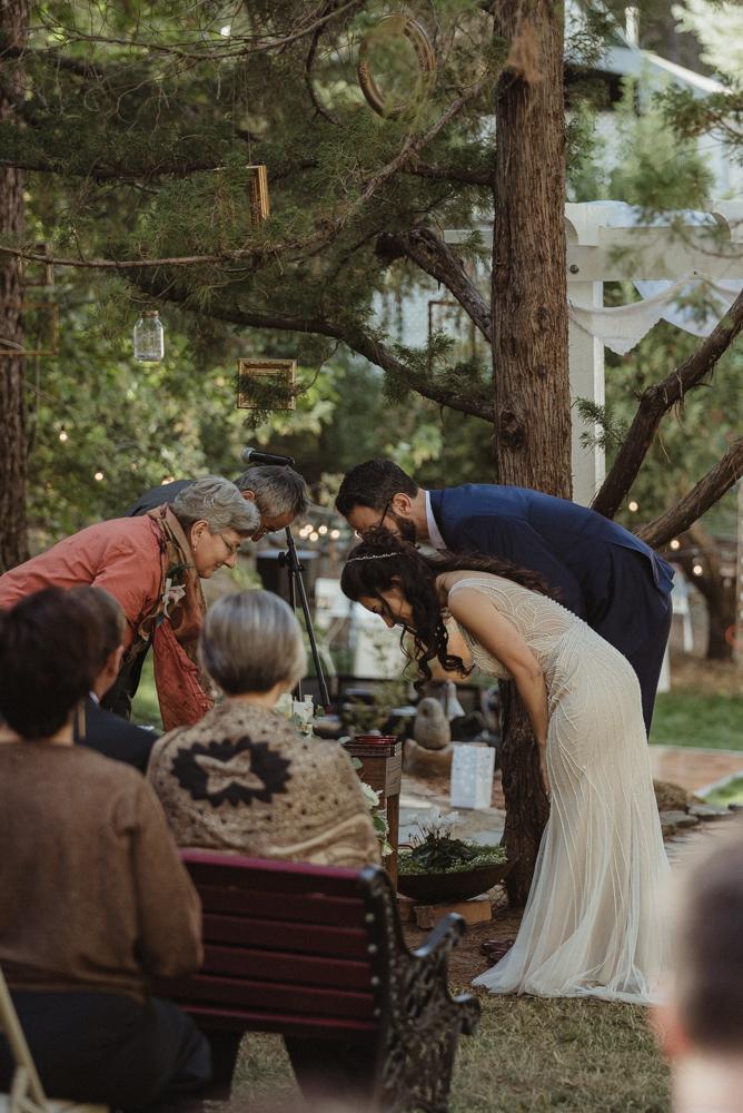 Nevada City wedding Japanese ceremony family bowing down photo