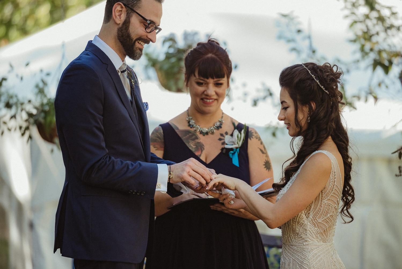 Nevada City wedding exchanging rings photo
