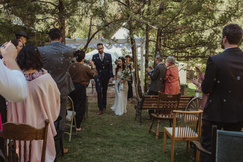 Nevada City wedding bride and groom walking down the isle photo
