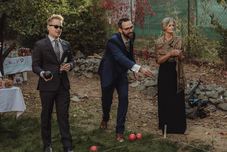 Nevada City wedding reception groom playing bocce ball photo