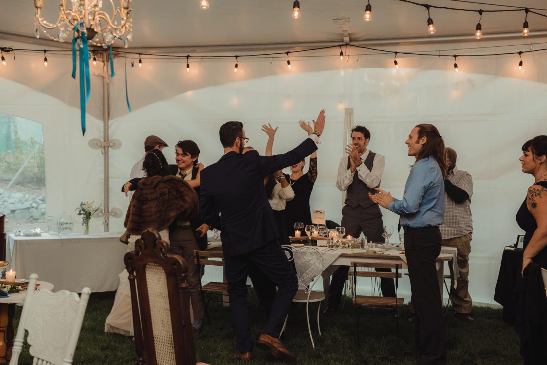 Nevada City wedding reception guests cheering photo