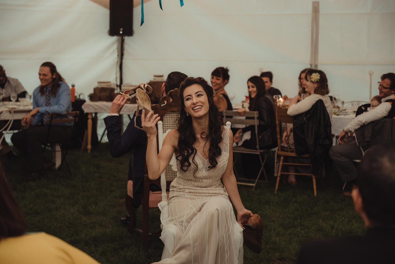 Nevada City wedding reception shoe game bride photo