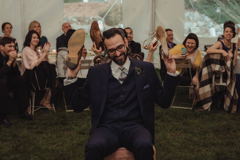 Nevada City wedding reception shoe game groom photo