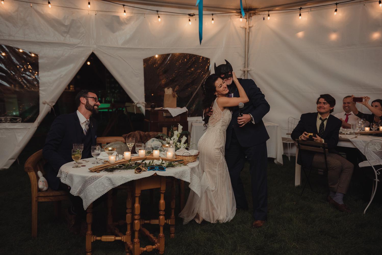 Nevada City wedding reception bride hugging batman photo