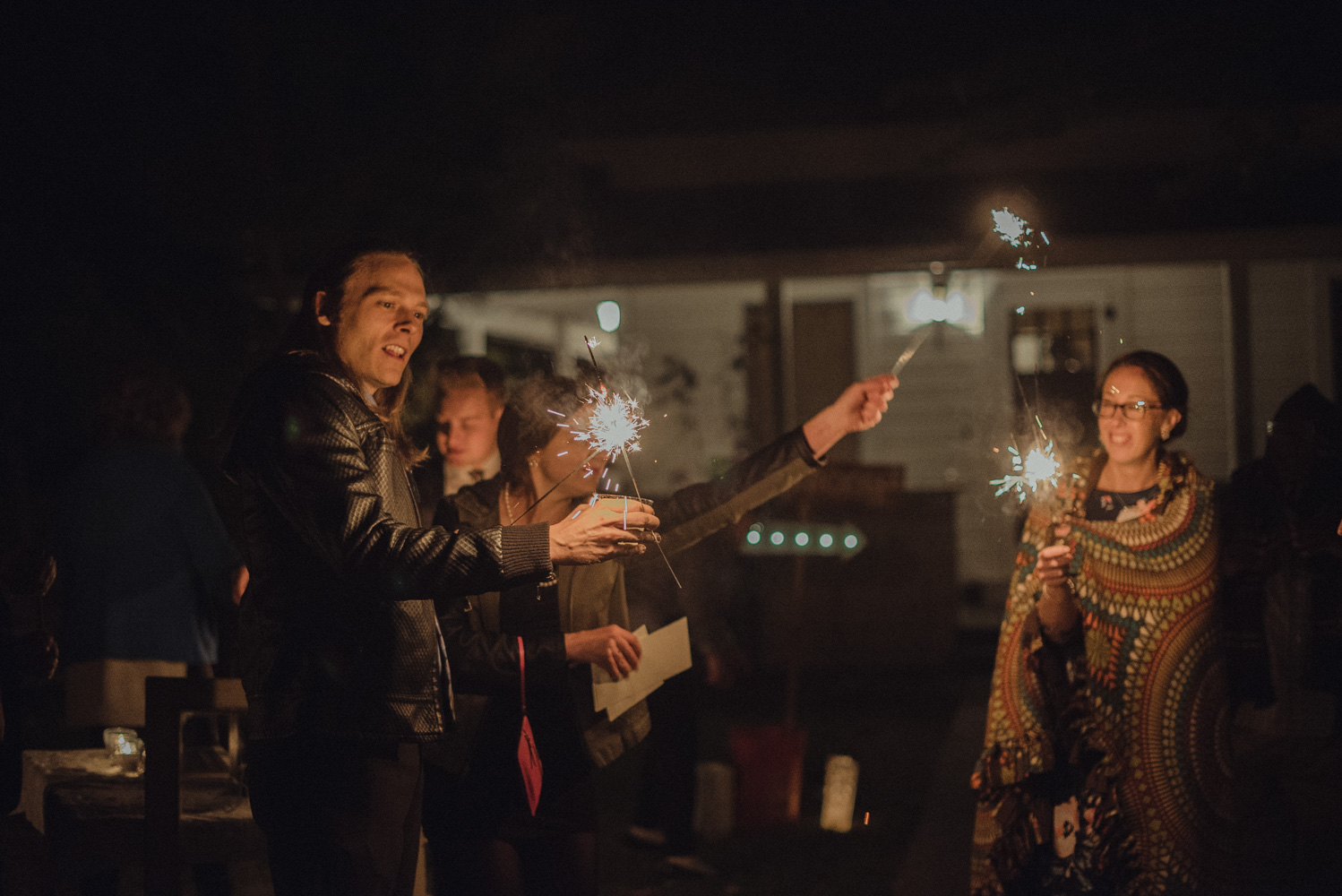 Nevada City wedding guests turning on their sparklers photo