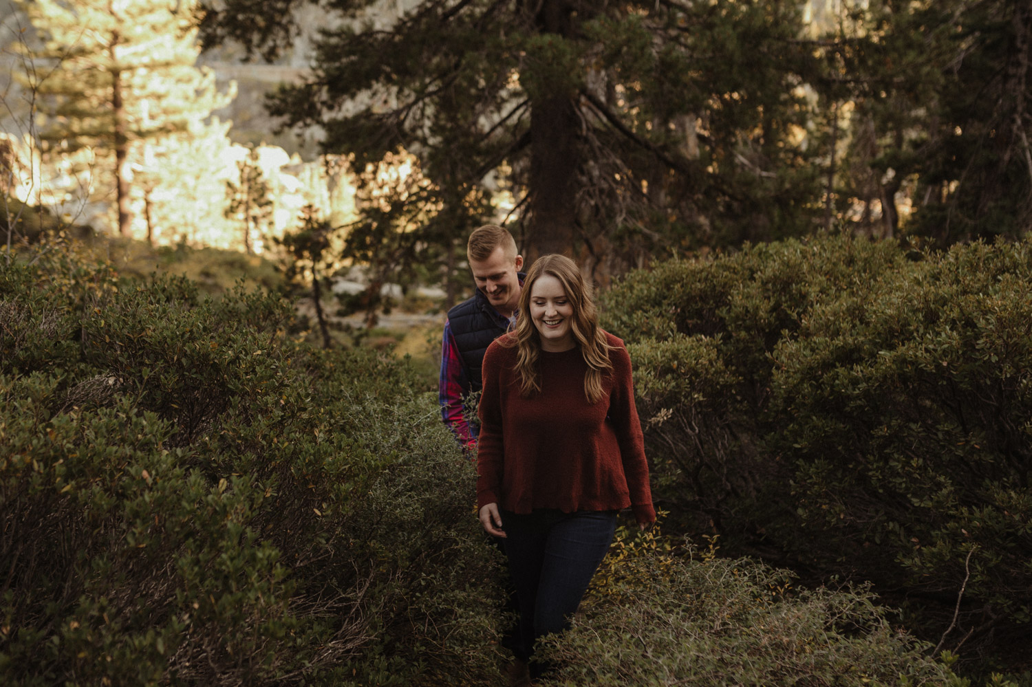 Donner Engagement session couple walking on a trail photo.