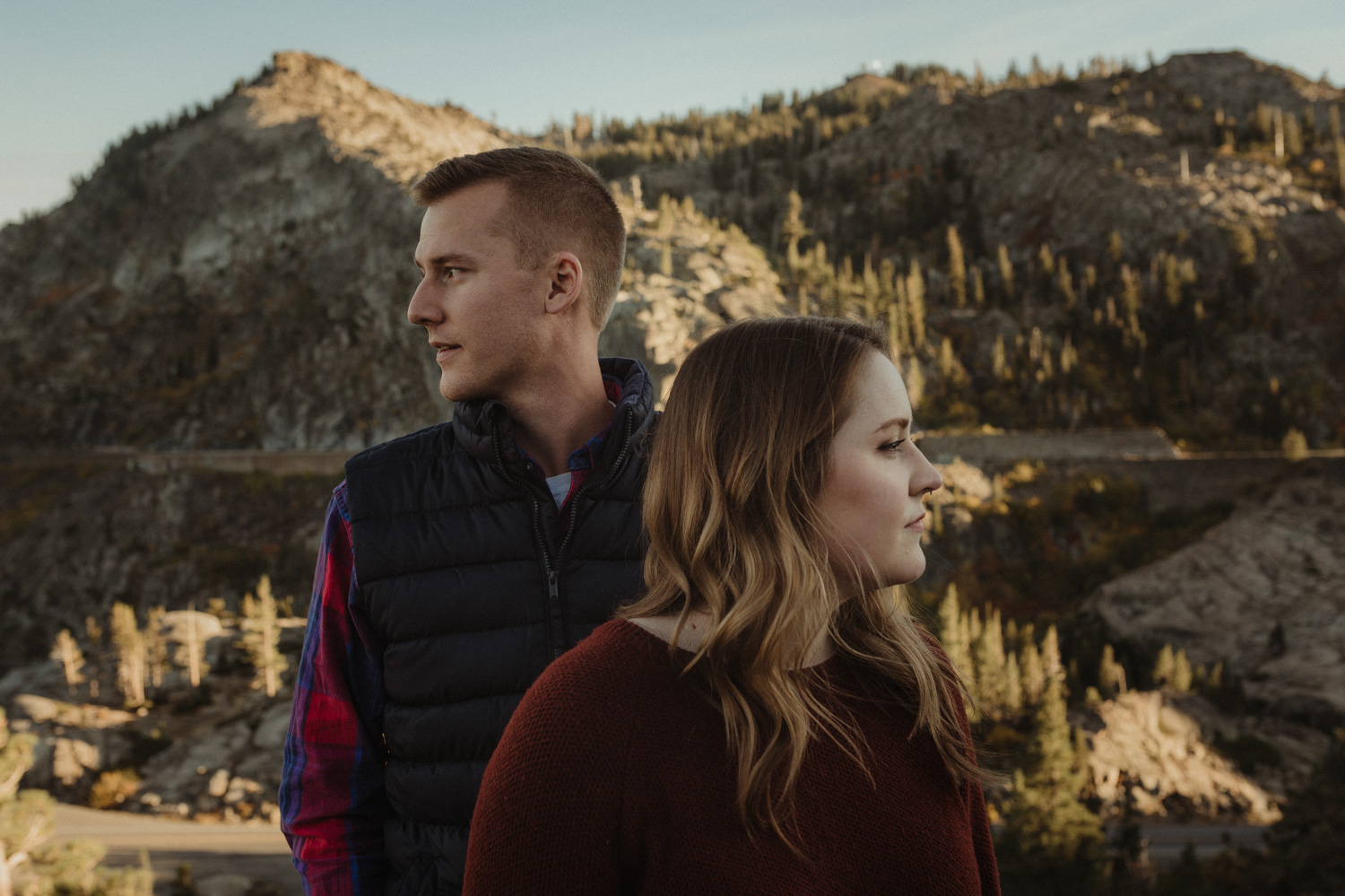 Donner Pass, CA engagement session couple staring opposite directions photo