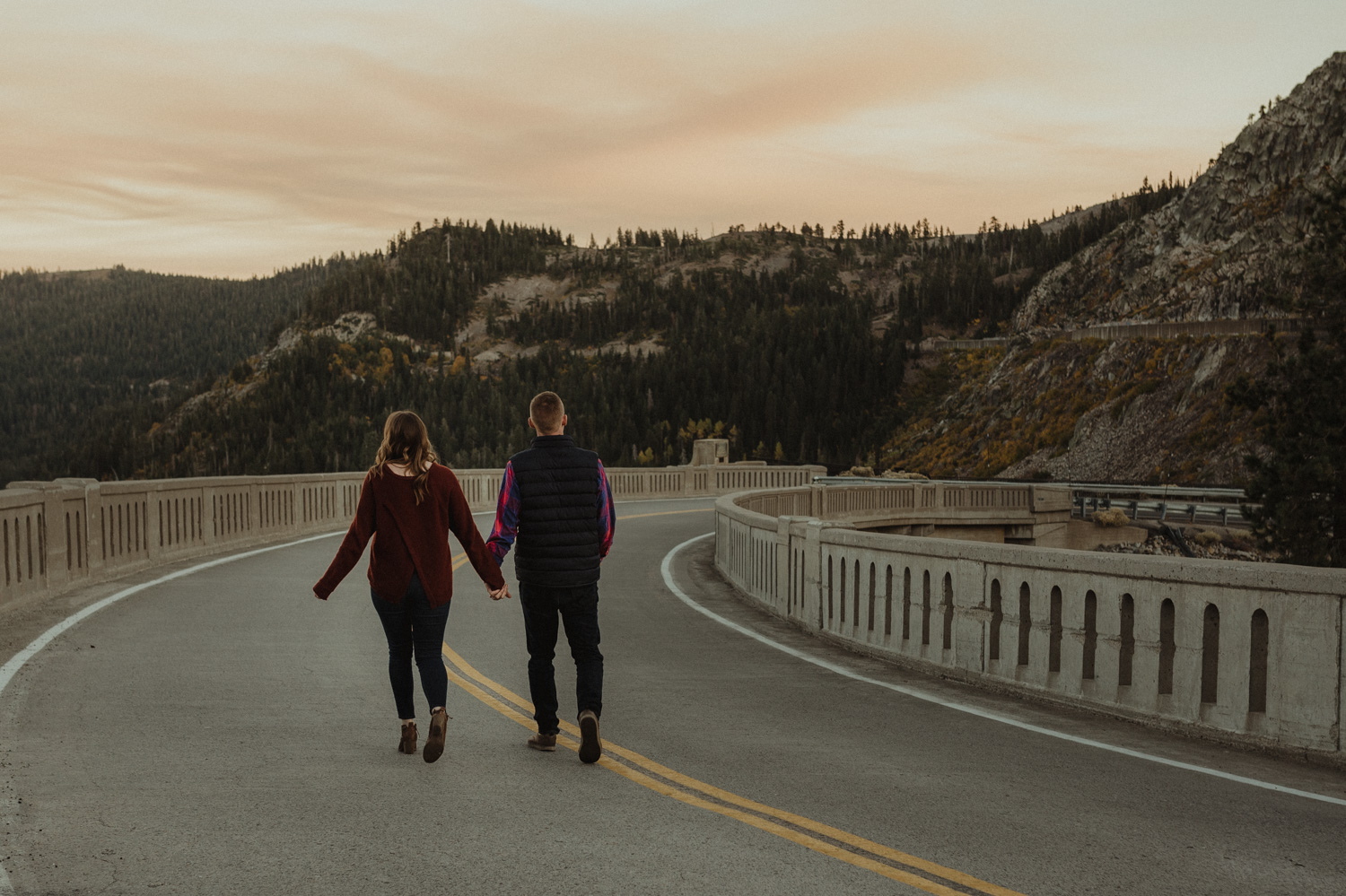 Donner Pass, CA engagement session couple walking down the road photo
