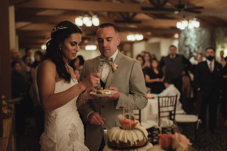Tannenbaum Wedding Venue couple enjoying their cake photo