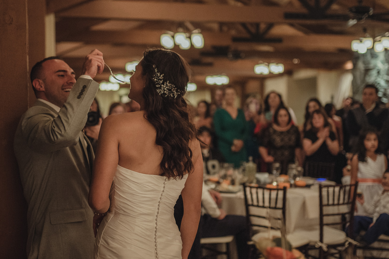 Tannenbaum Wedding Venue groom feeding the cake to his bride photo