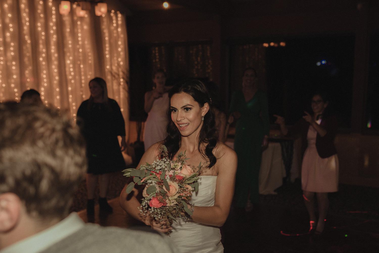 Tannenbaum Wedding Venue bride getting ready to throw her bouquet photo