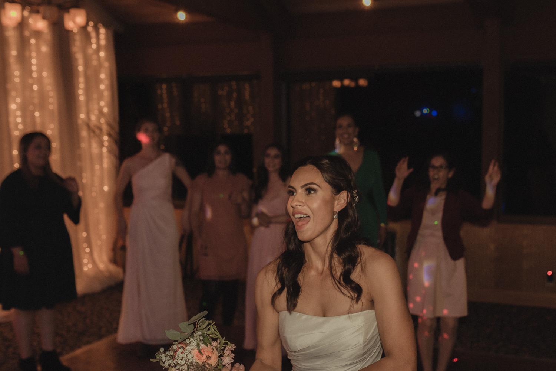 Tannenbaum Wedding Venue bride about to throw her bouquet photo