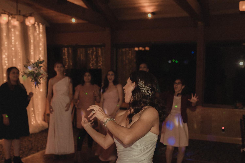 Tannenbaum Wedding Venue bride throwing her bouquet photo