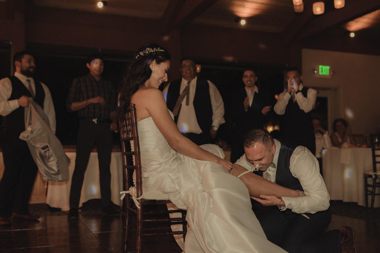 Tannenbaum Wedding Venue groom under the brides dress photo