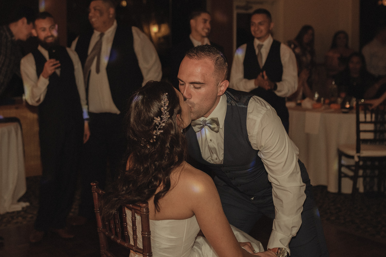 Tannenbaum Wedding Venue groom kissing his bride photo
