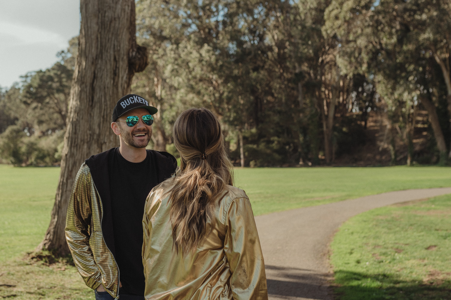 San Francisco engagement photos at Golden Gate Park couple looking at each other photo