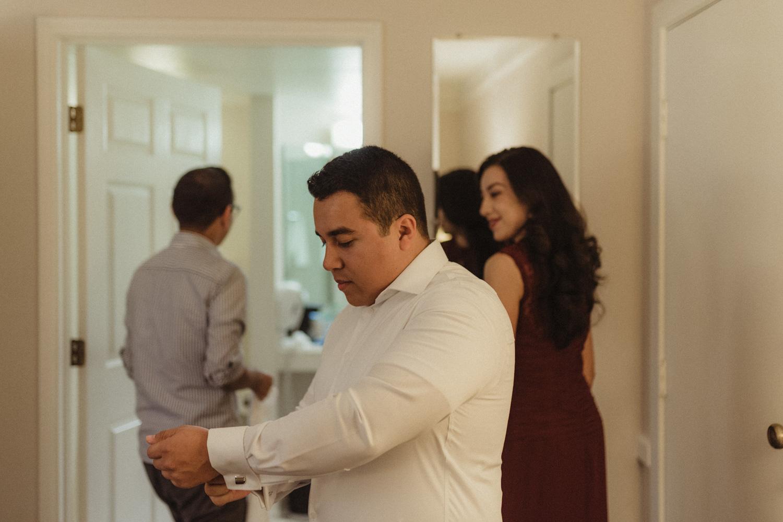 Logan Shoals elopement groom fixing his cuffs photo