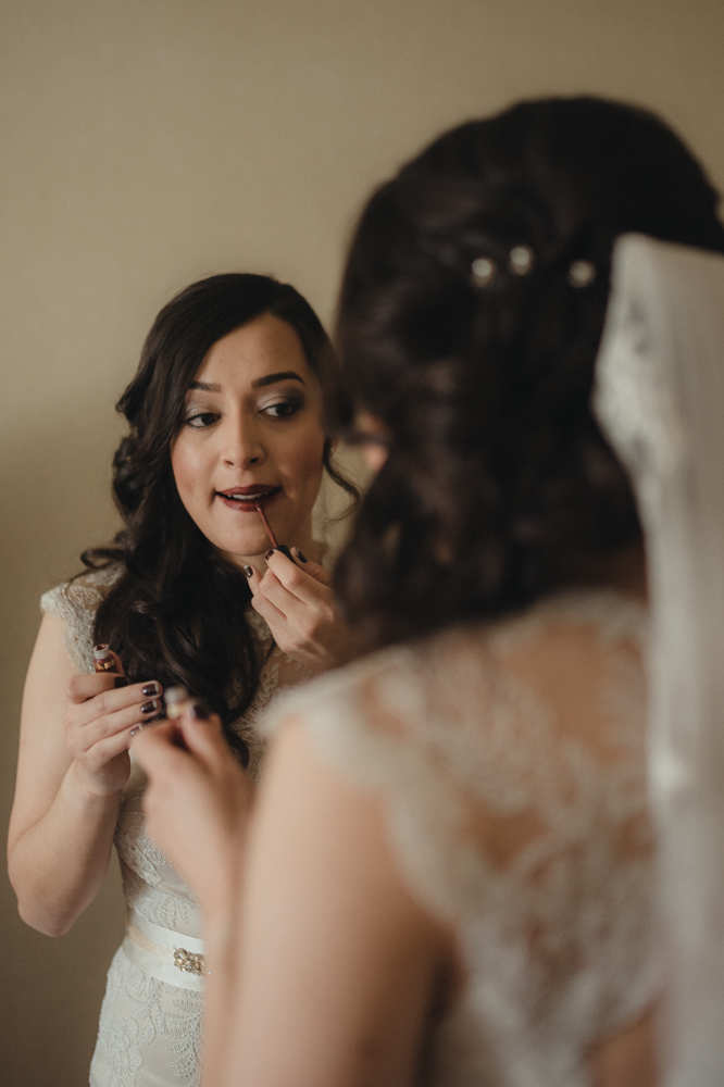 Logan Shoals elopement bride putting on her lipstick photo