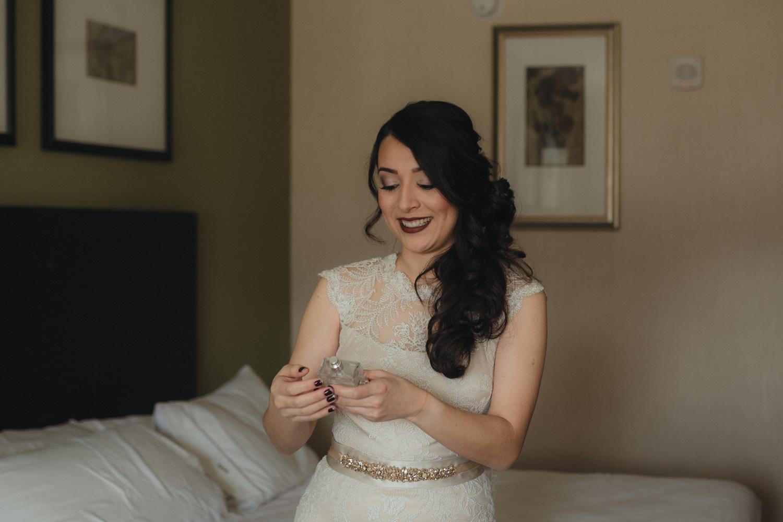 Logan Shoals elopement bride spraying on her perfume photo