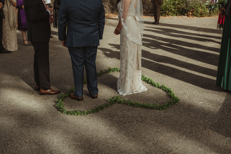 Logan Shoals elopement couple standing in a heart shaped arrangement photo
