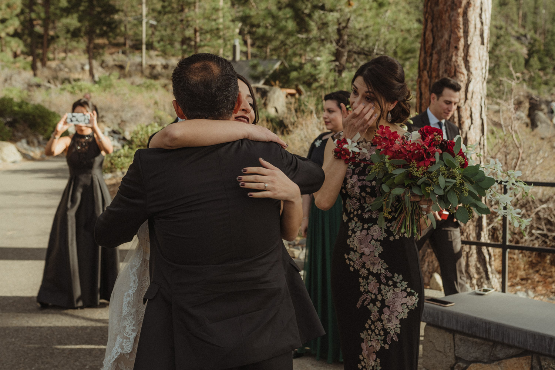 Logan Shoals elopement bride hugging her dad photo