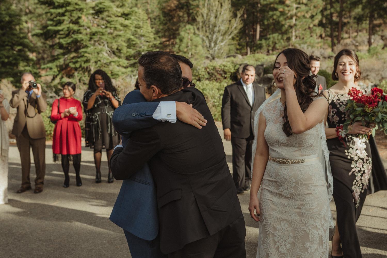 Logan Shoals elopement groom hugging his dad-in-law photo